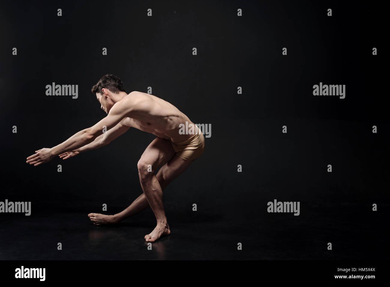 Artistic ballet dancer performing in the studio - Stock Image