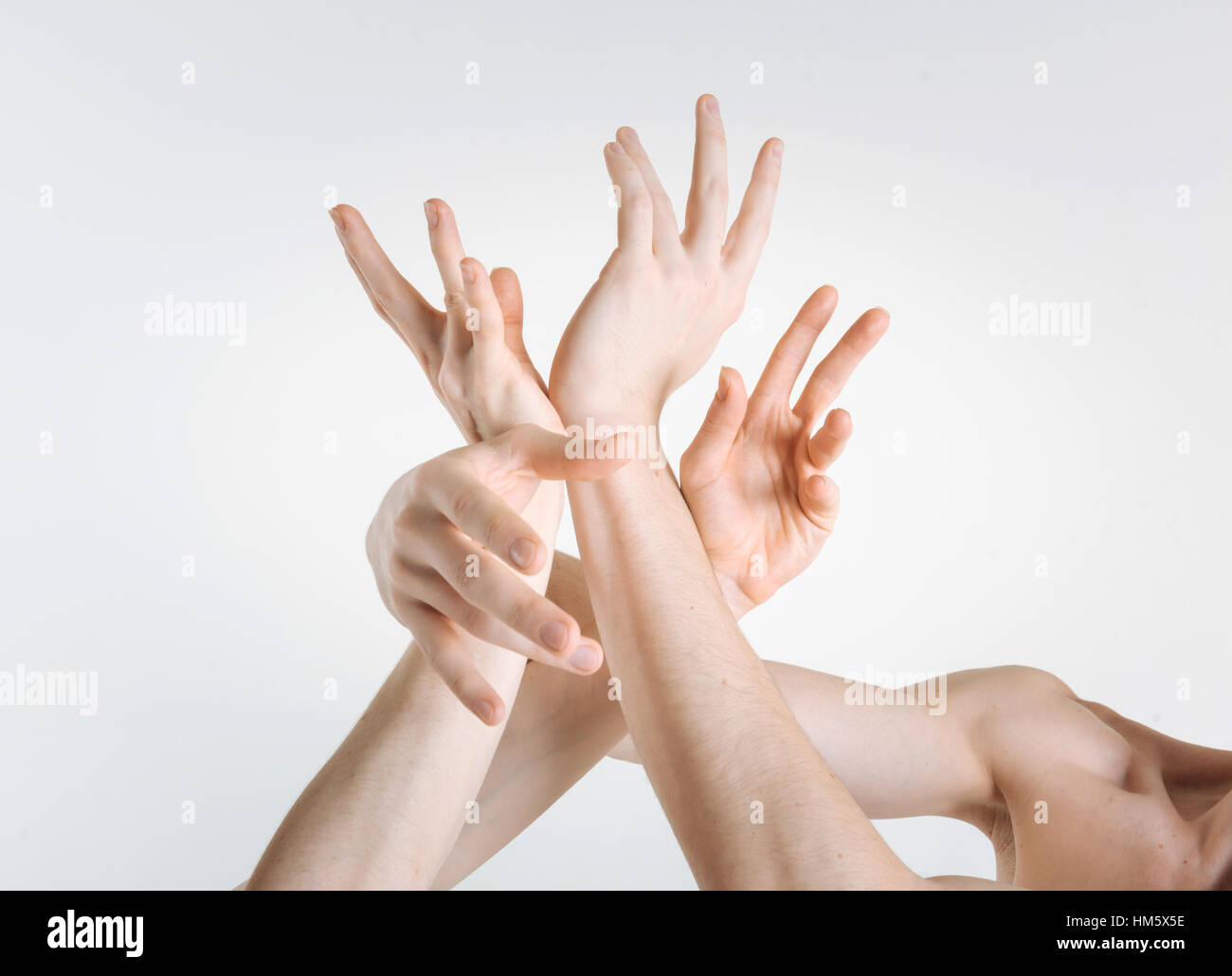 Sophisticated gymnasts hands expressing grace in the studio - Stock Image