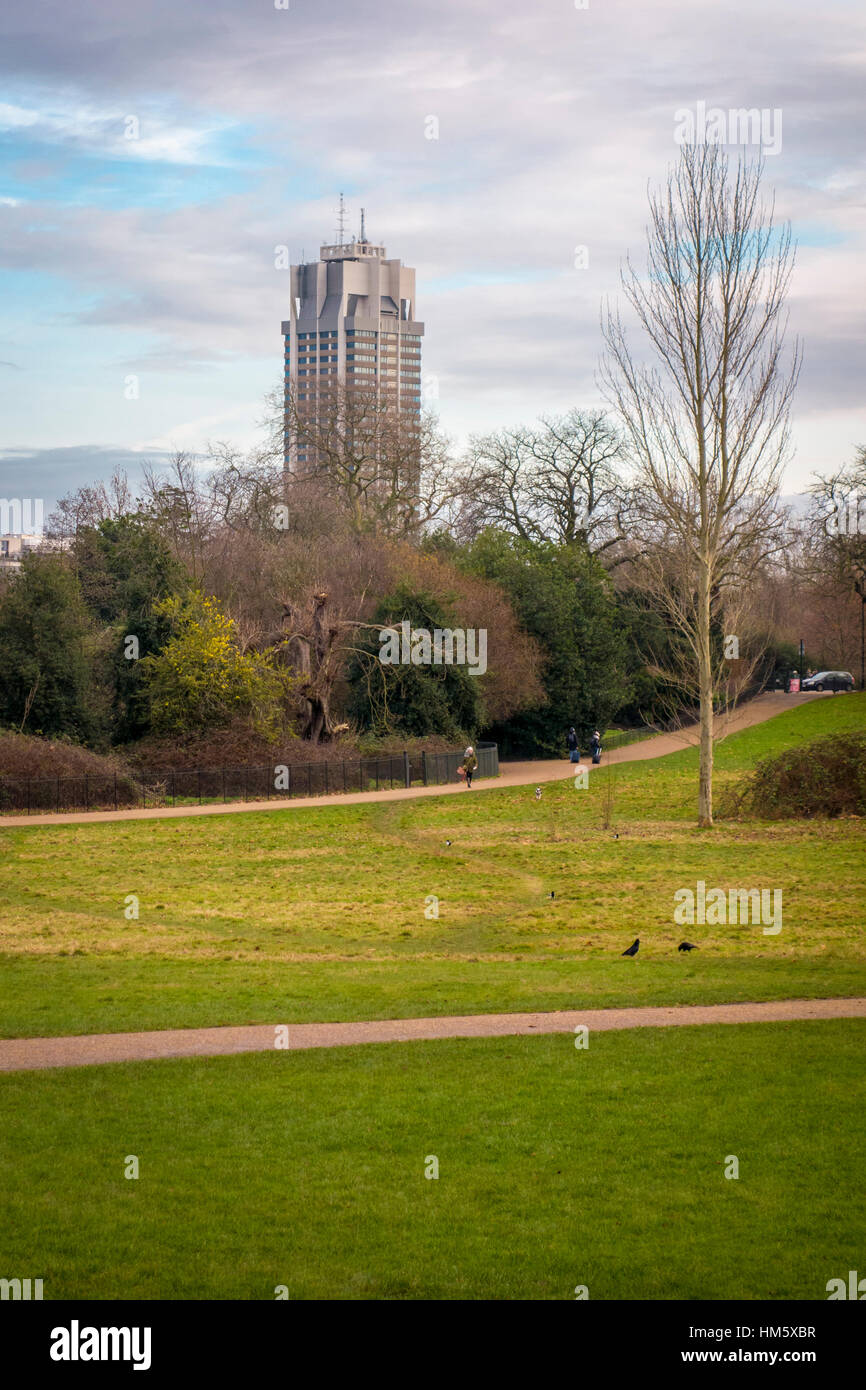 Kensington Gardens with Basil Spence's tower (Hyde Park Barracks) in the background, London, UK - Stock Image