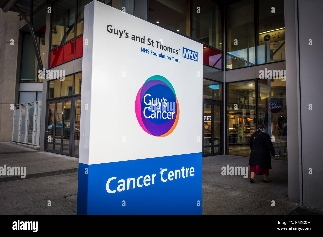 Cancer Centre sign outside the building entrance, Guy's and St Thomas' Hospital, London, UK - Stock Image