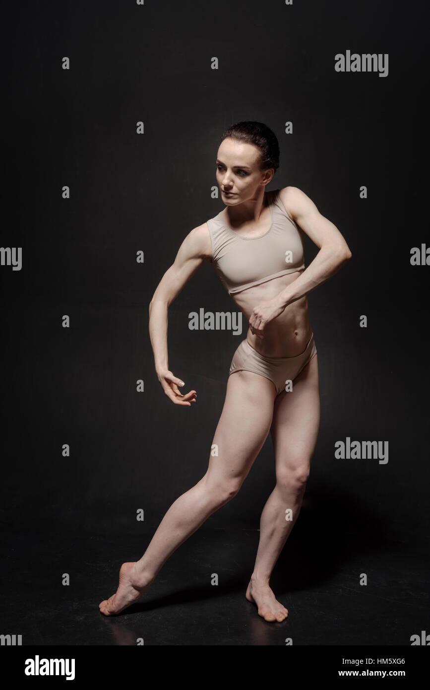 Involved ballet dancer standing in the studio - Stock Image