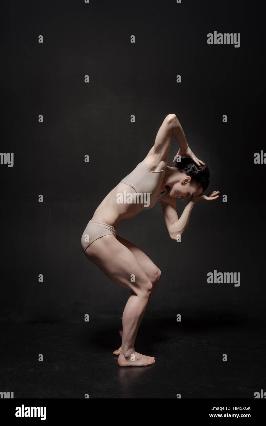 Puzzled young ballet dancer realizing her abilities and skills - Stock Image