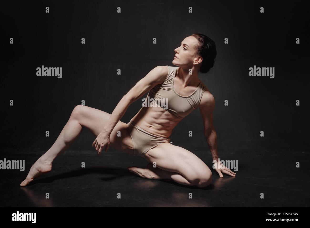 Attractive young ballet dancer dancing in the studio - Stock Image