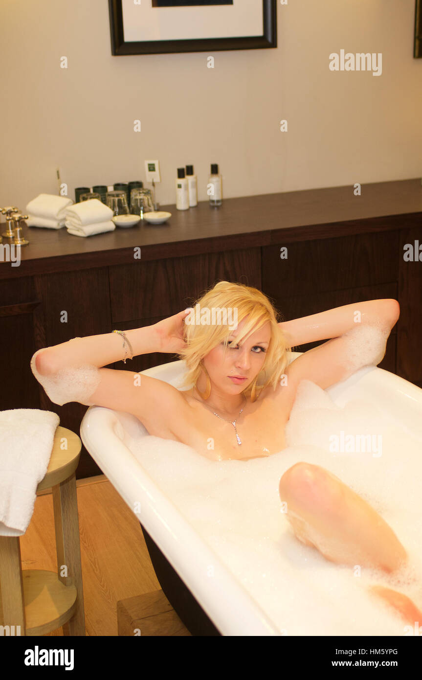 Pretty Blonde Young Woman In Bath With Bubbles