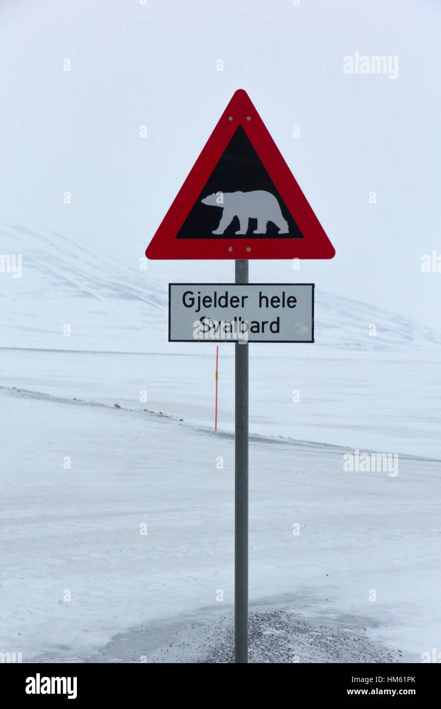 Roadside warning sign for polar bears on the islands of Spitsbergen, Norway. Stock Photo