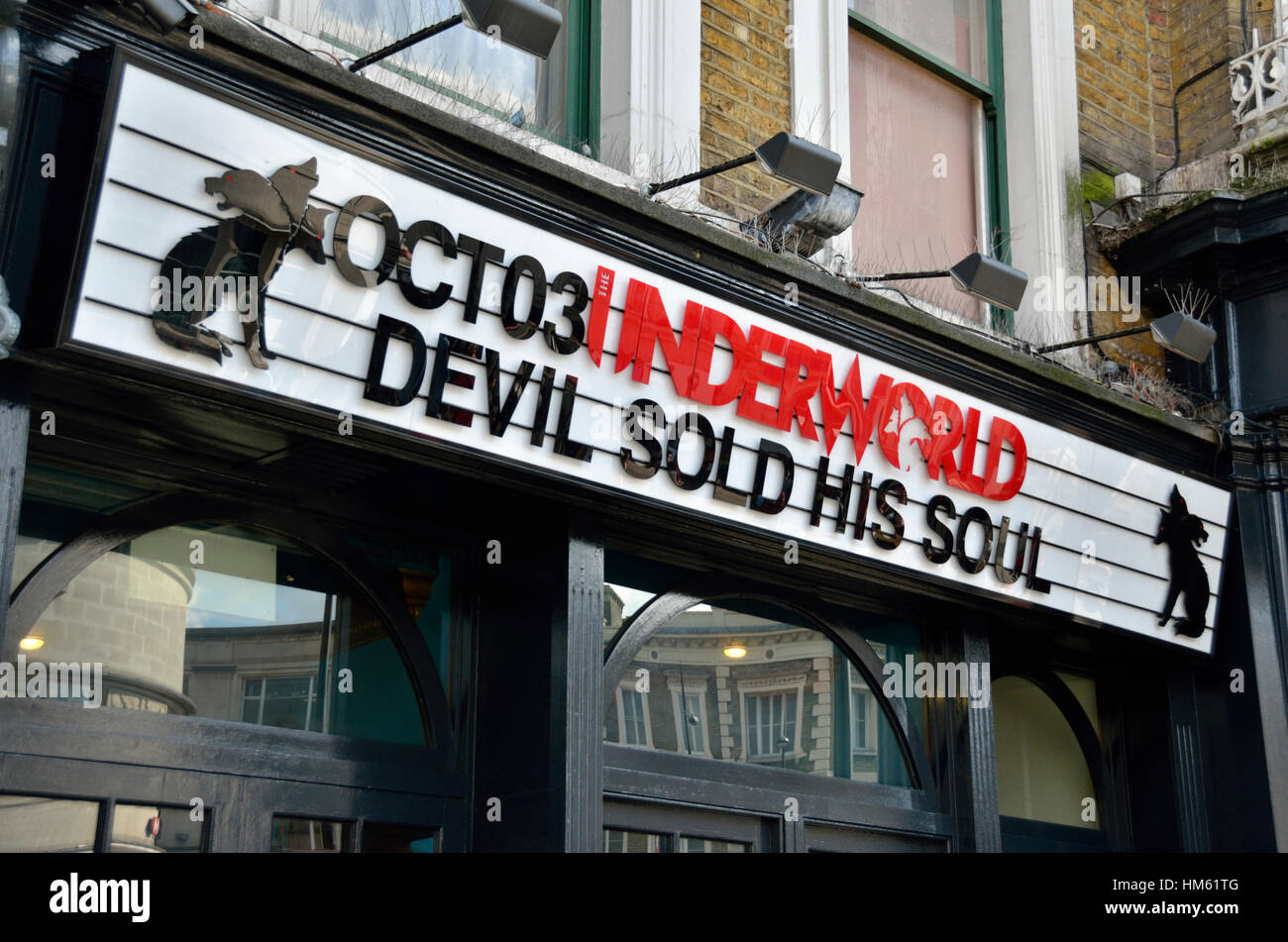 Hoarding promoting the band Devil Sold his Soul outside the Underworld music venue in Camden Town, London, UK. - Stock Image