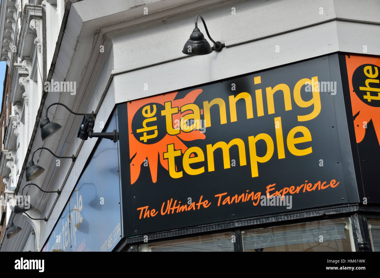 Tanning shop sign - Stock Image