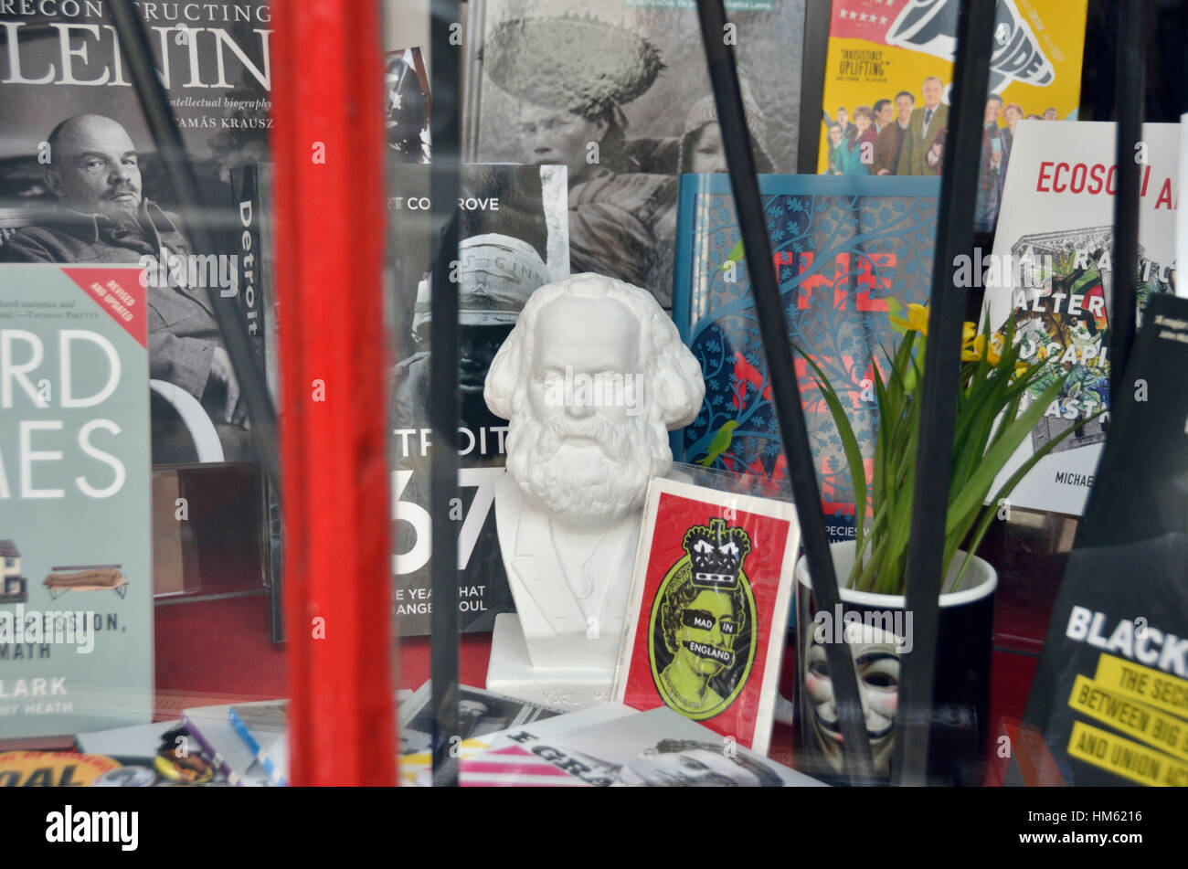 Statue of Karl Mark in a socialist bookshop window - Stock Image