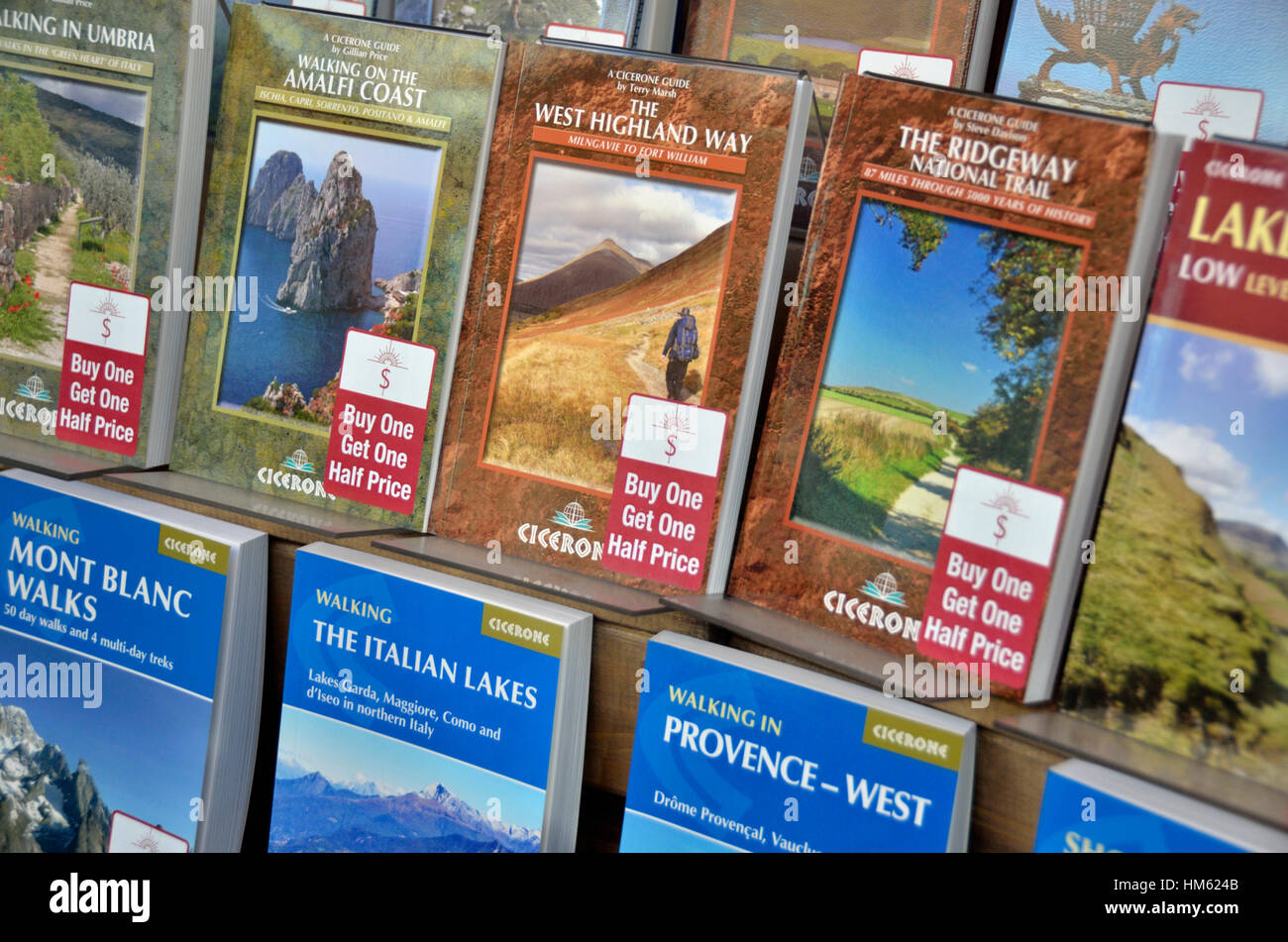 Cicerone walking guide books in a shop window display - Stock Image
