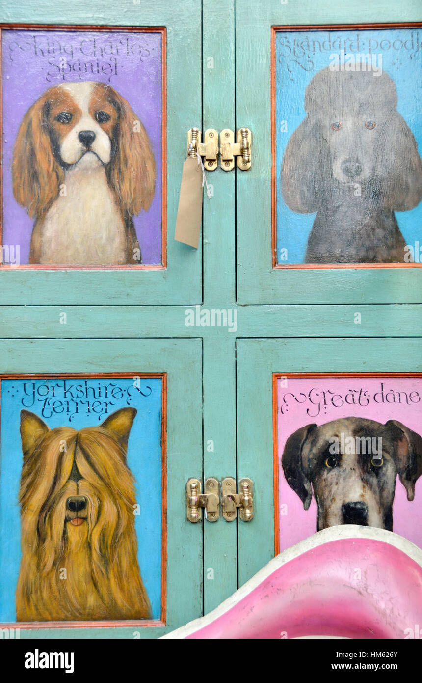 A variety of different dog breeds painted on cabinet doors - Stock Image