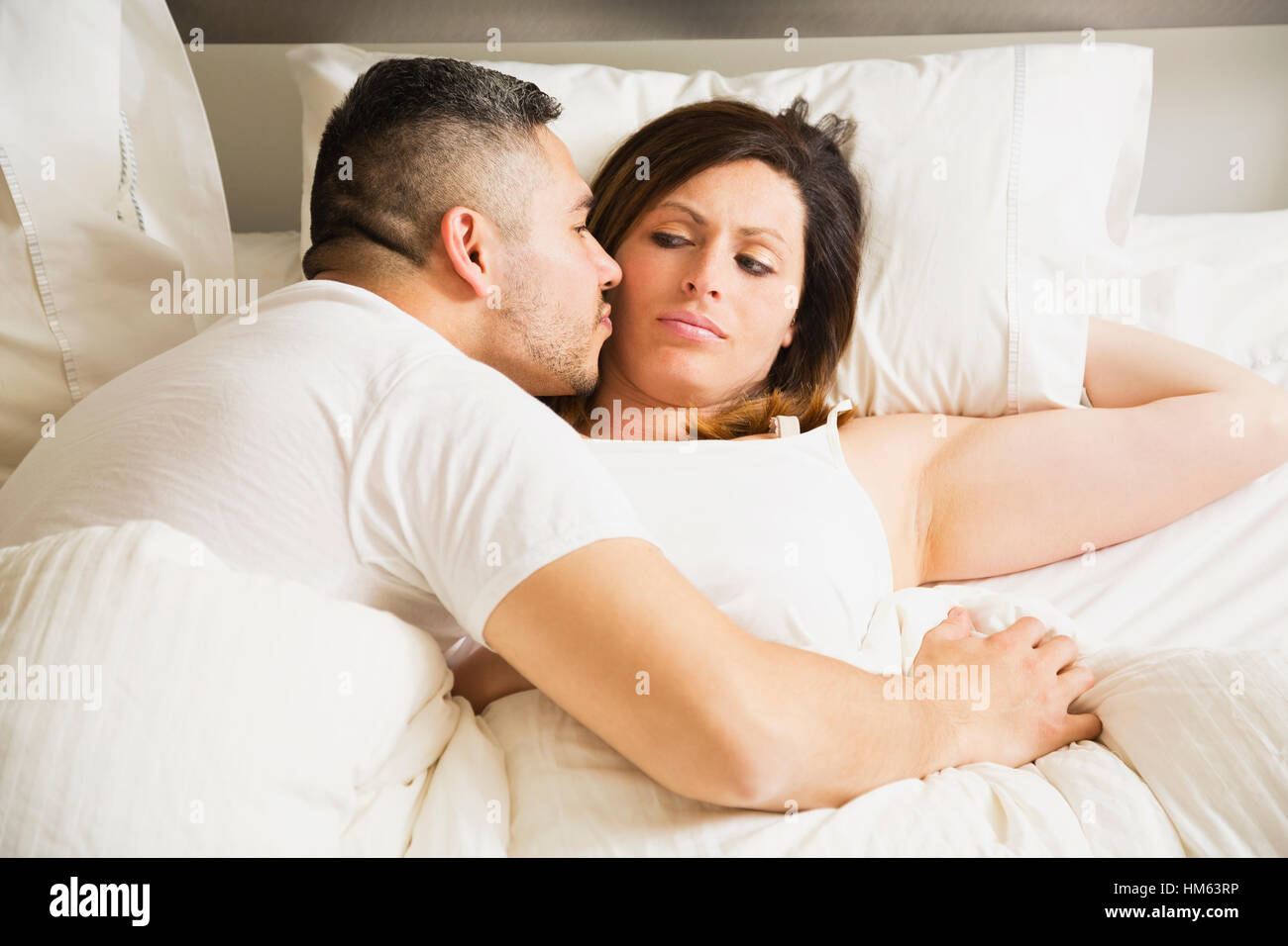 Husband trying to kiss wife - Stock Image