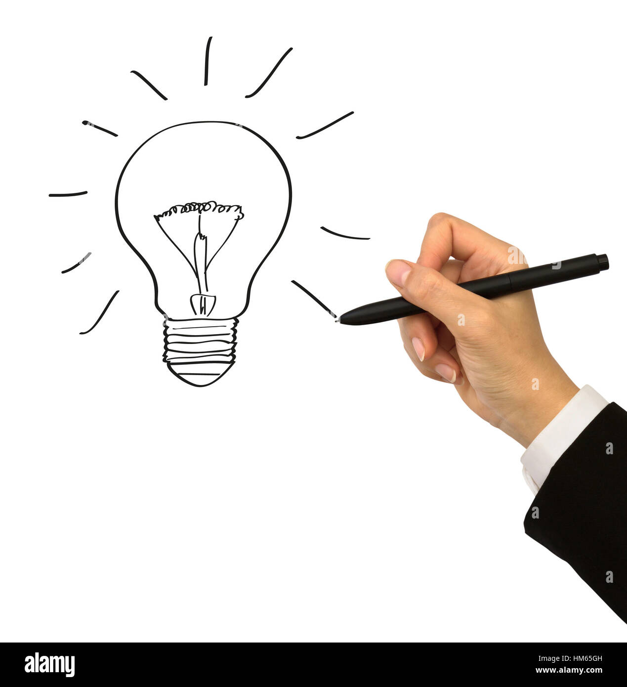 Business man with a pen drawing light bulb - Stock Image