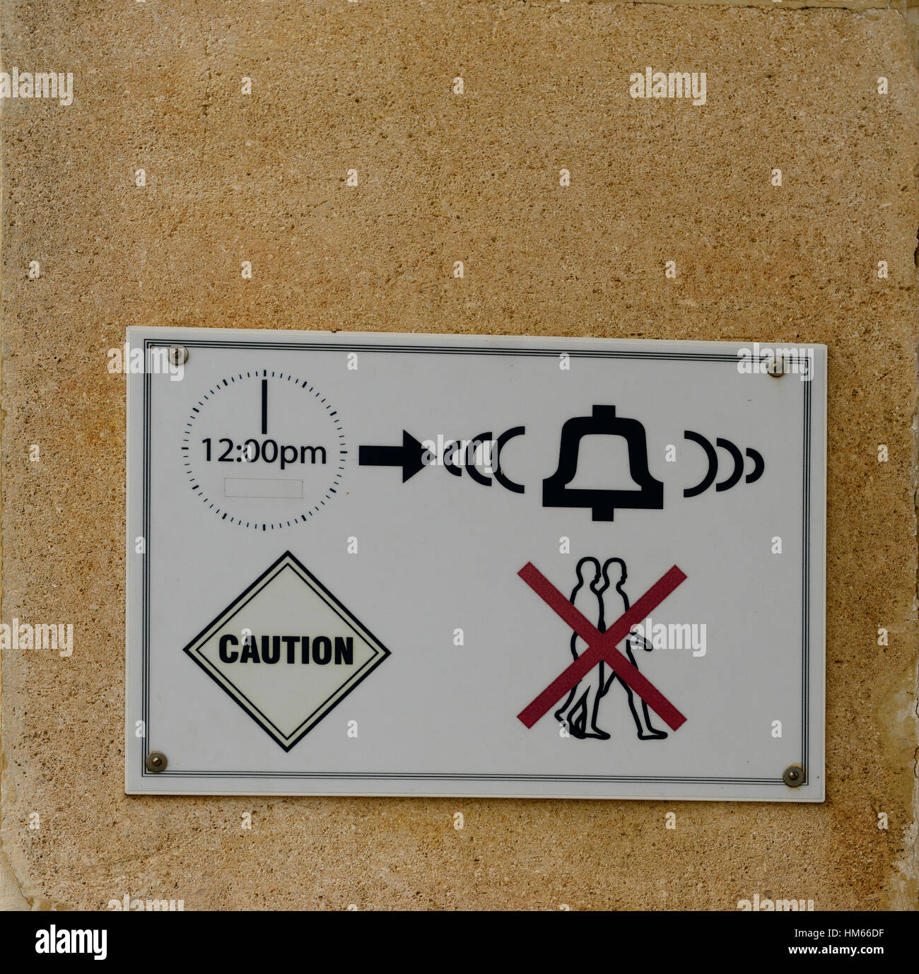 sign caution warn warning signs advance notice loud deafen deafening noise bell ring ringing midday noon alarm signal - Stock Image