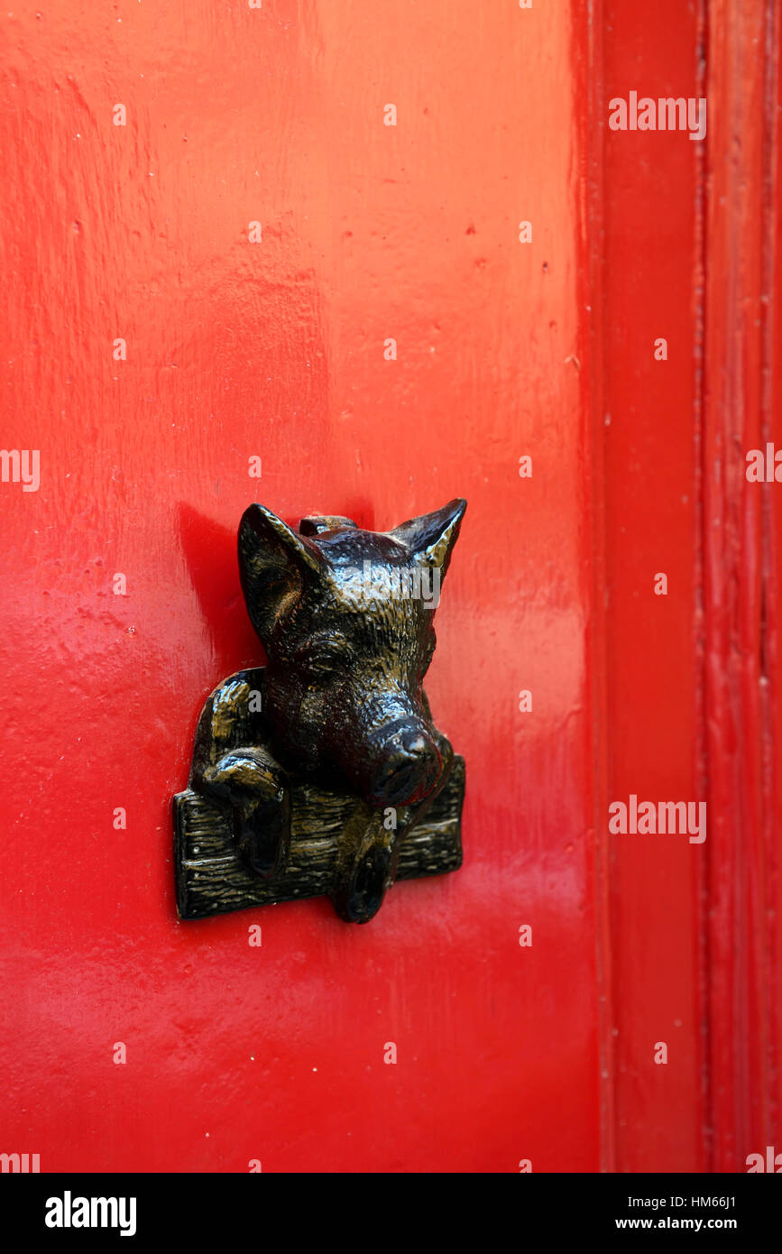boar pig door knocker handle red doors feature design home house Valletta Malta renowned known associated tourism - Stock Image