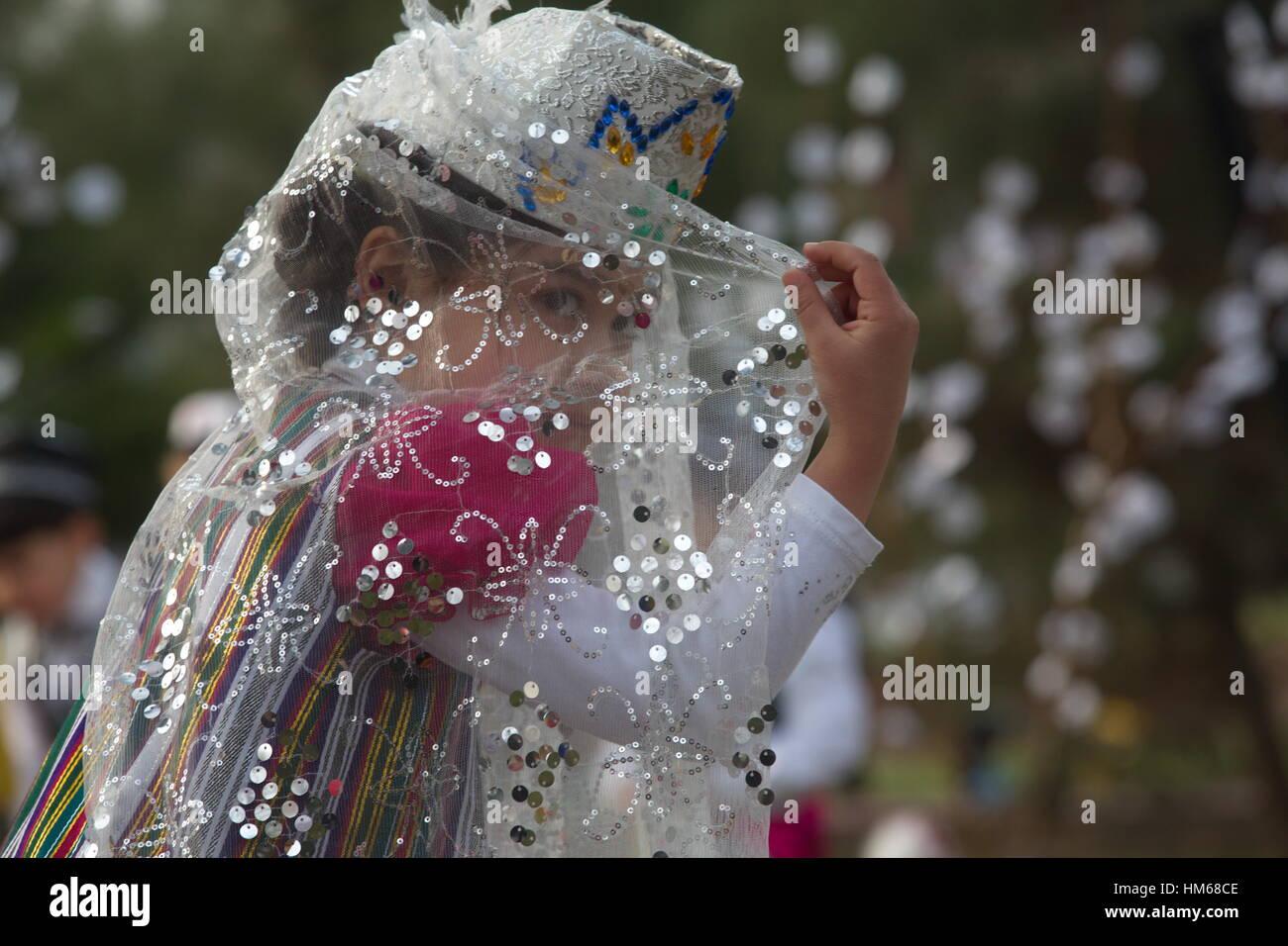 Girls dancing traditional oriental dance during the celebration of Navruz in Khujand city in Republic of Tajikistan - Stock Image