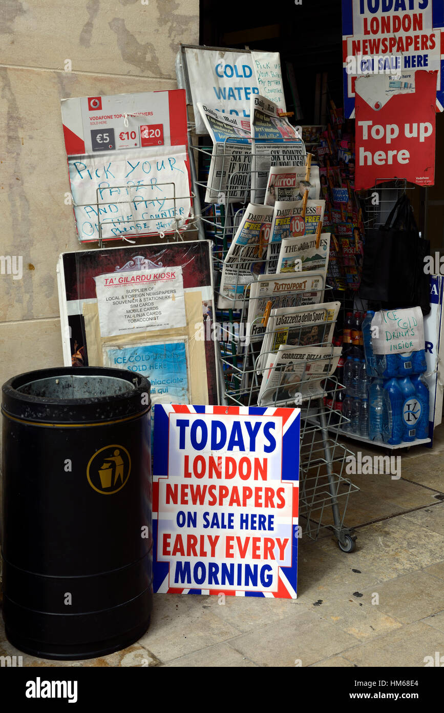 english british UK news newspapers papers on for sale newsagent newsagents Valletta Malta abroad rapid communication same day Stock Photo