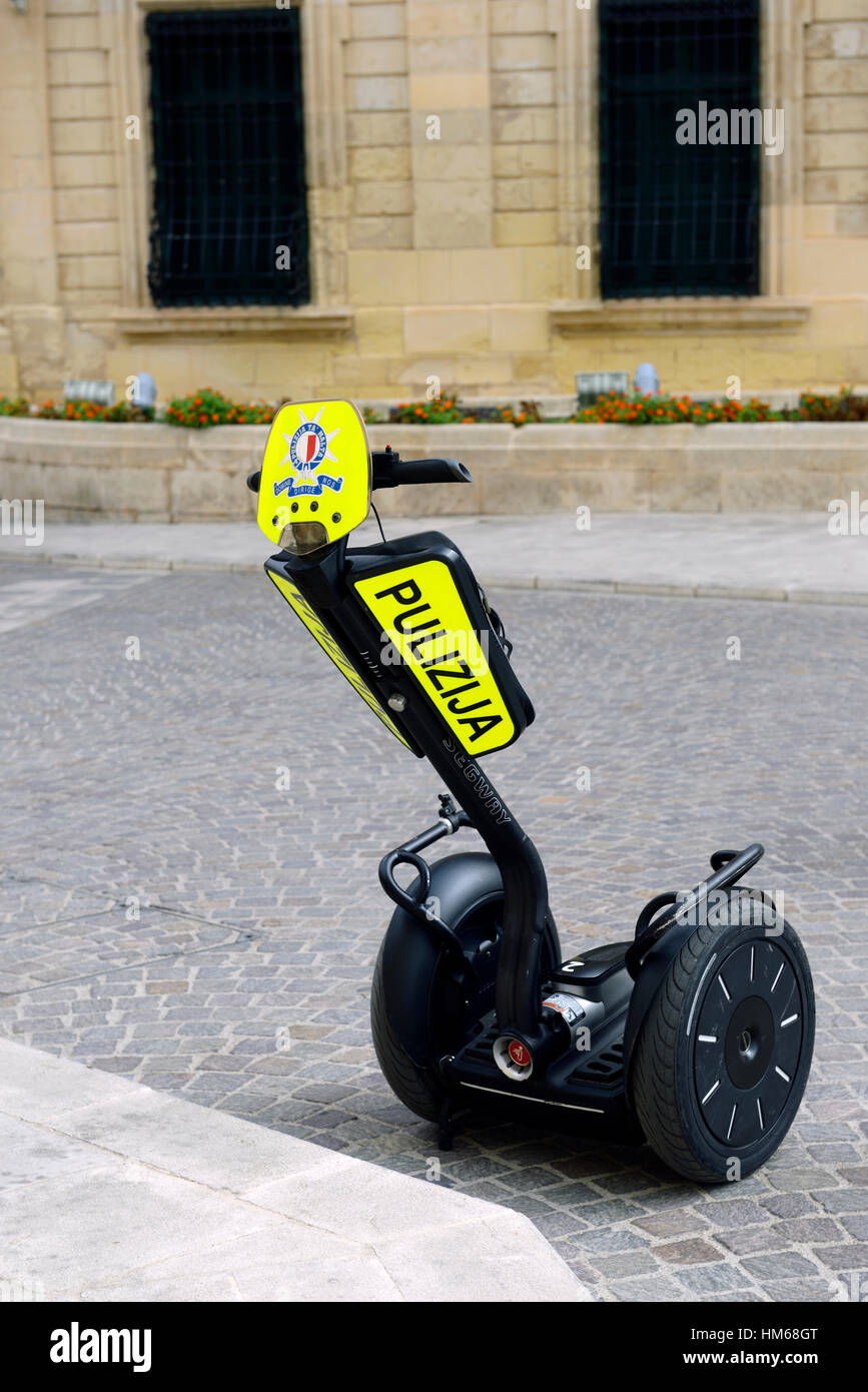 segway Malta police force pulizija transport rapid mobile quick nimble policing ability personal vehicle cop cops - Stock Image