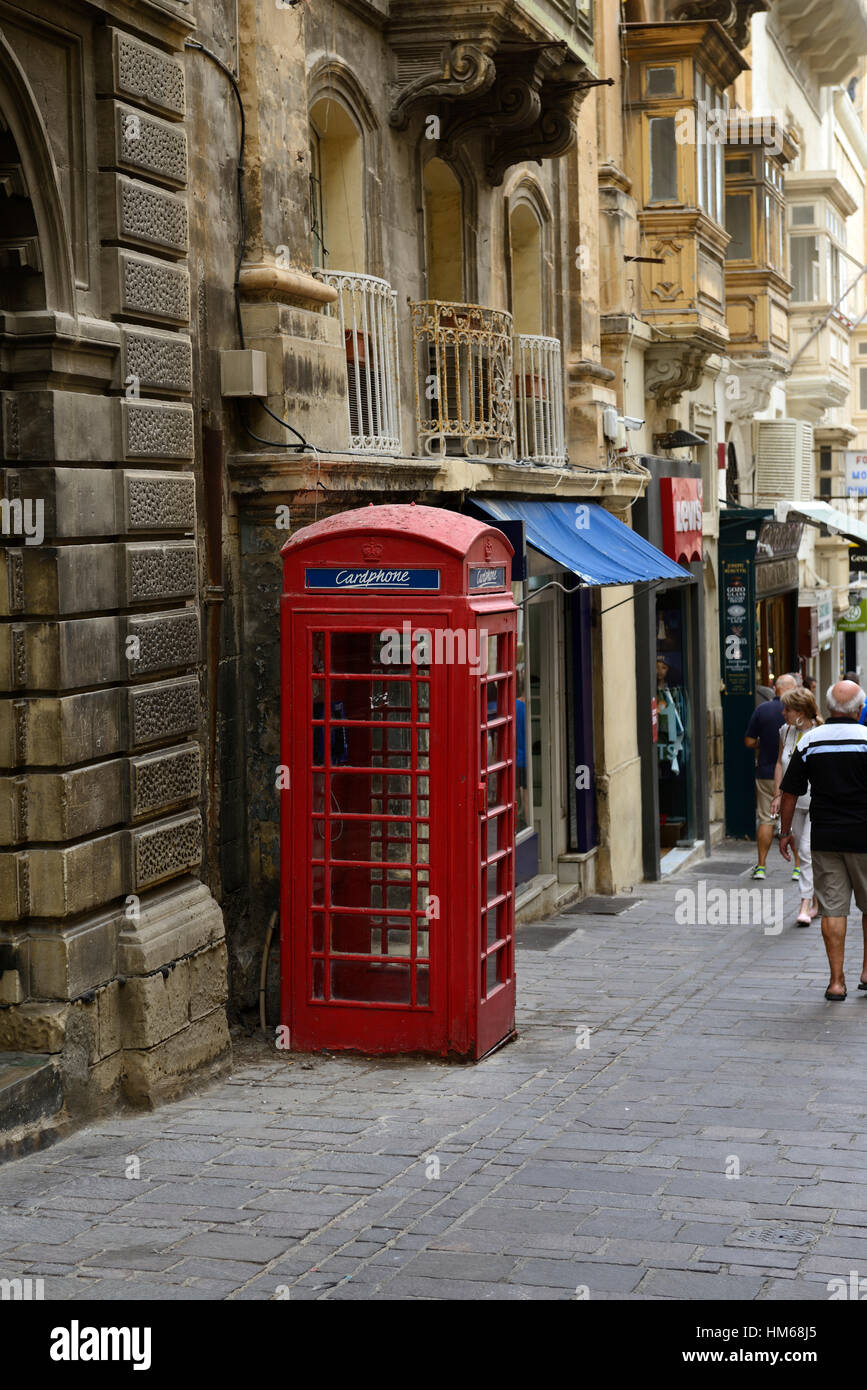 red telephone box Valletta Malta traditional pillar style english british rule throwback telecommunications system - Stock Image