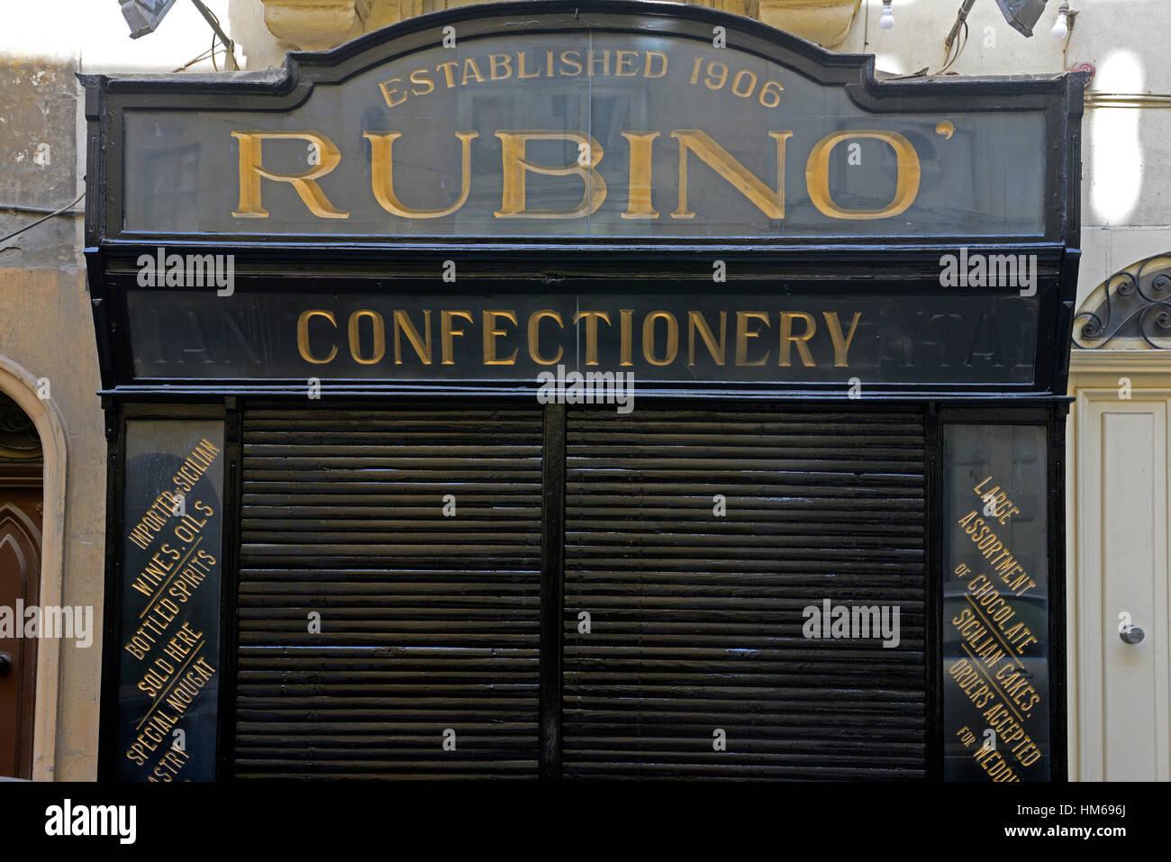 Rubino Confectionary restaurant door doorway business entrance traditional old style shopfront Valletta Malta RM - Stock Image