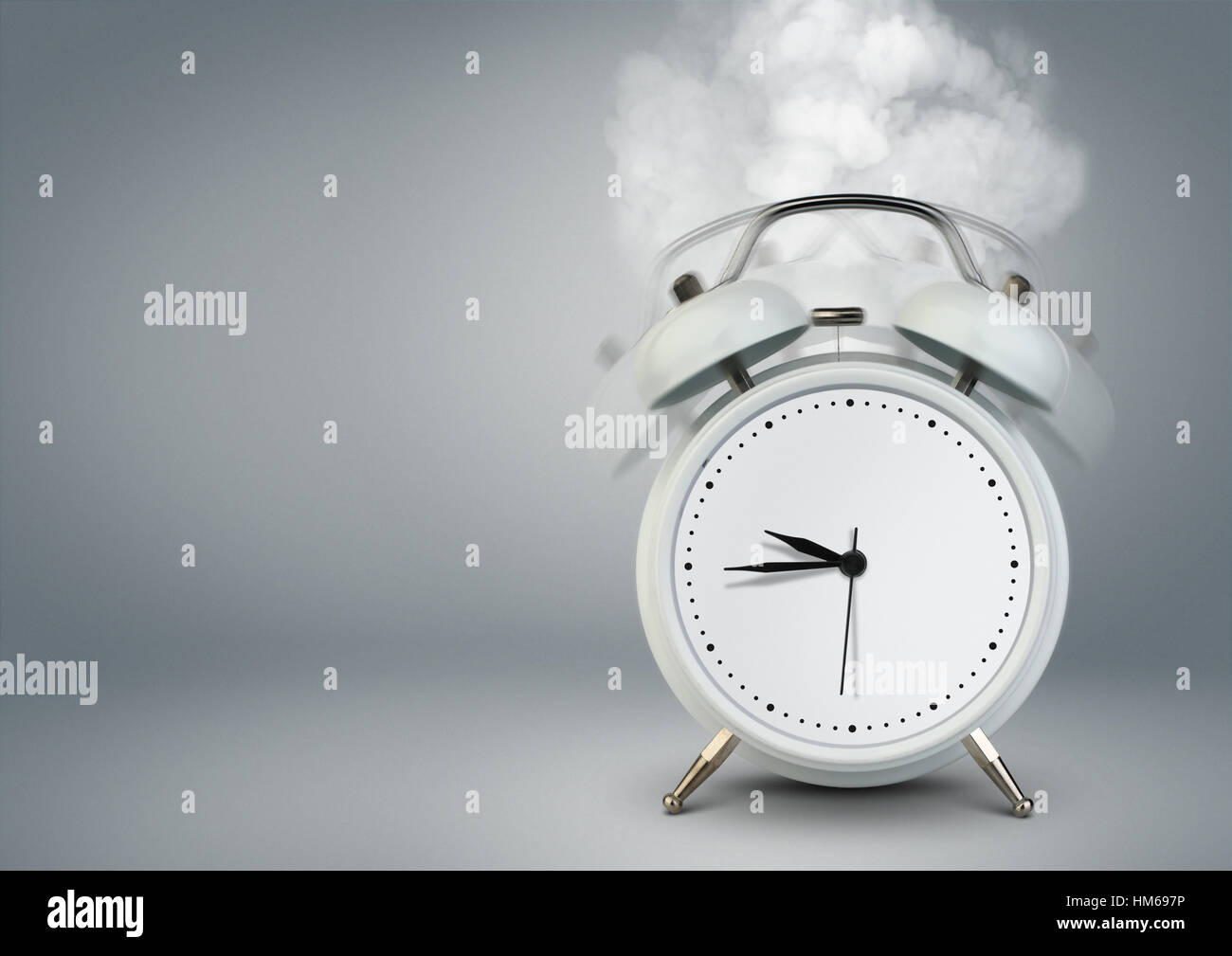 ringing clock on grey with copy space - Stock Image