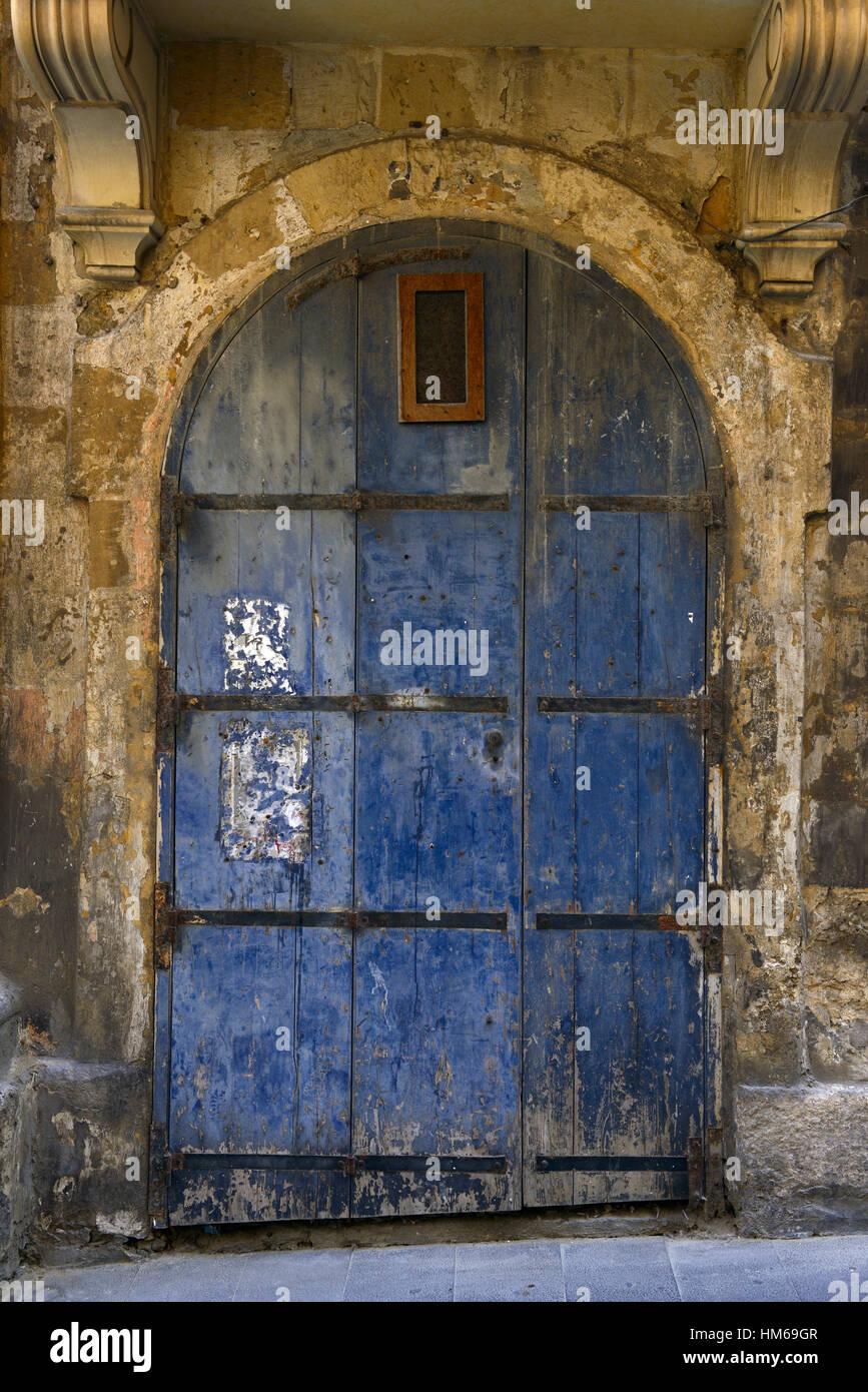 Old door doorway dilapidated run down untended decrepit Valletta Malta traditional attraction abandoned side streets - Stock Image