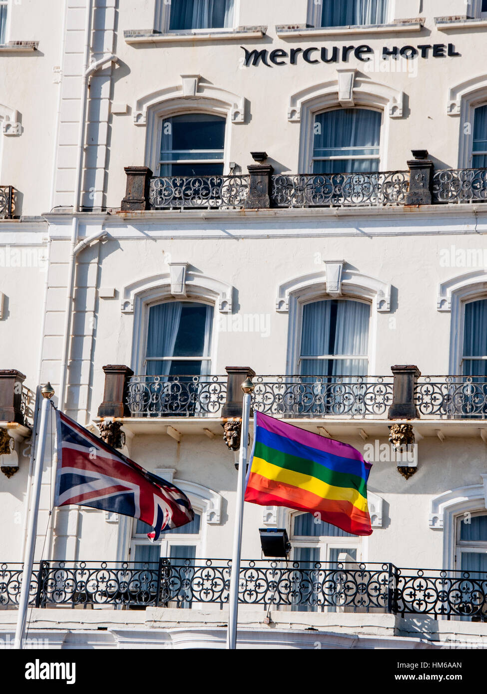 Image of Mercure hotel and British Jack flag and Pride flag  in Brighton during The Pride Festival Stock Photo