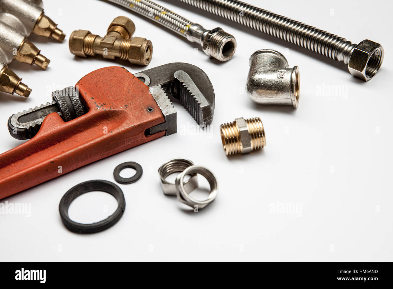 plumbing tools and equipment on white background with copy space Stock Photo