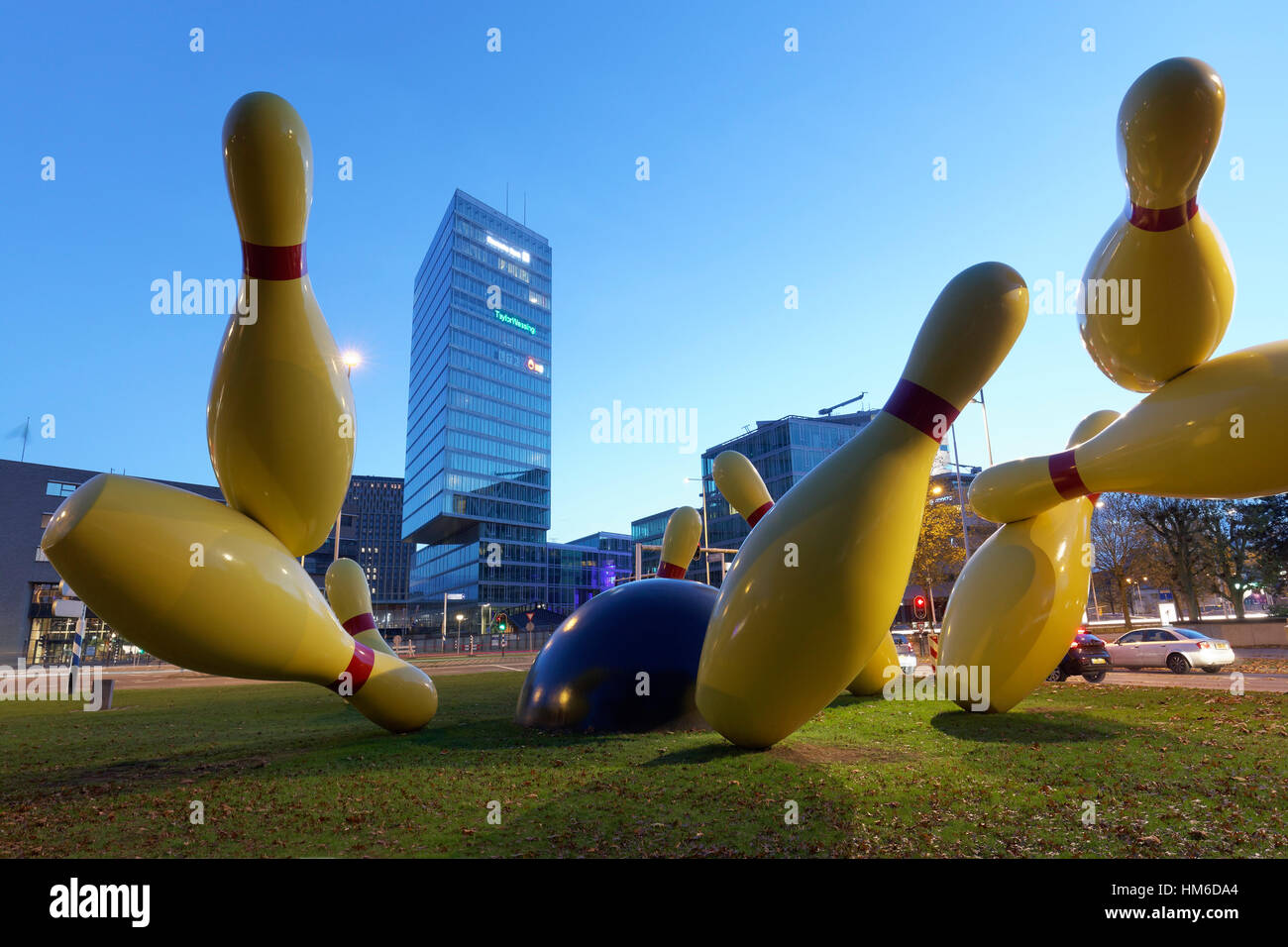 Flying Pins sculpture, pins are knocked down by bowling ball, artists Claes Oldenburg and Coosje van Bruggen, Pop - Stock Image