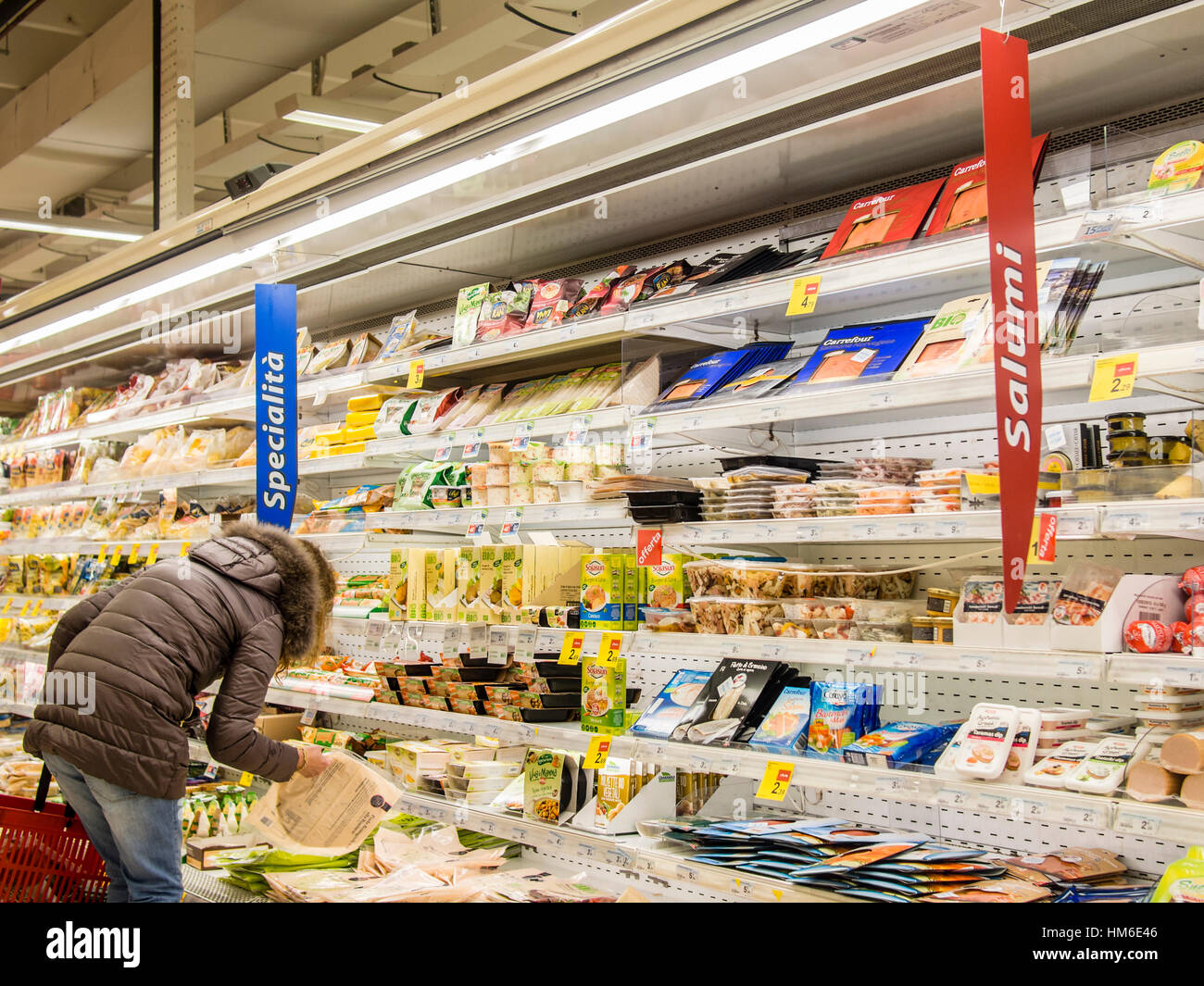 woman shopping at the carrefour market store cremona italy stock photo 132908502 alamy. Black Bedroom Furniture Sets. Home Design Ideas