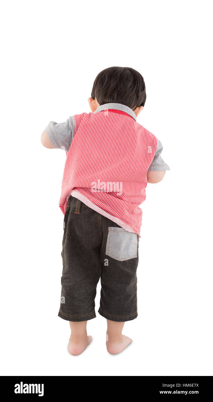 Back view of young boy looking over white background - Stock Image