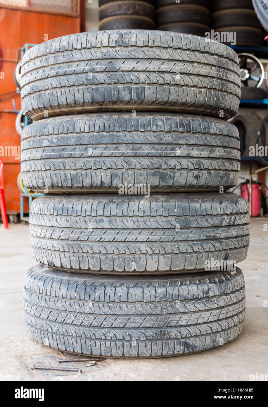 Stack of worn out rubber tire - Stock Image