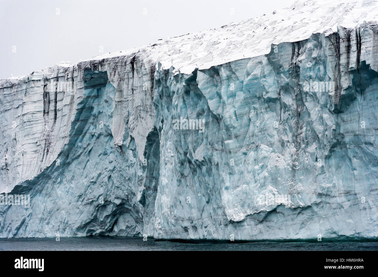 The tortured ice fracture zone of a glacier above the ocean. - Stock Image