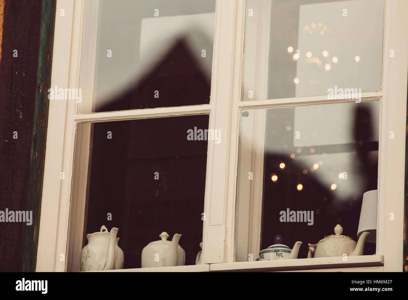 View in a window with teapots - Stock Image