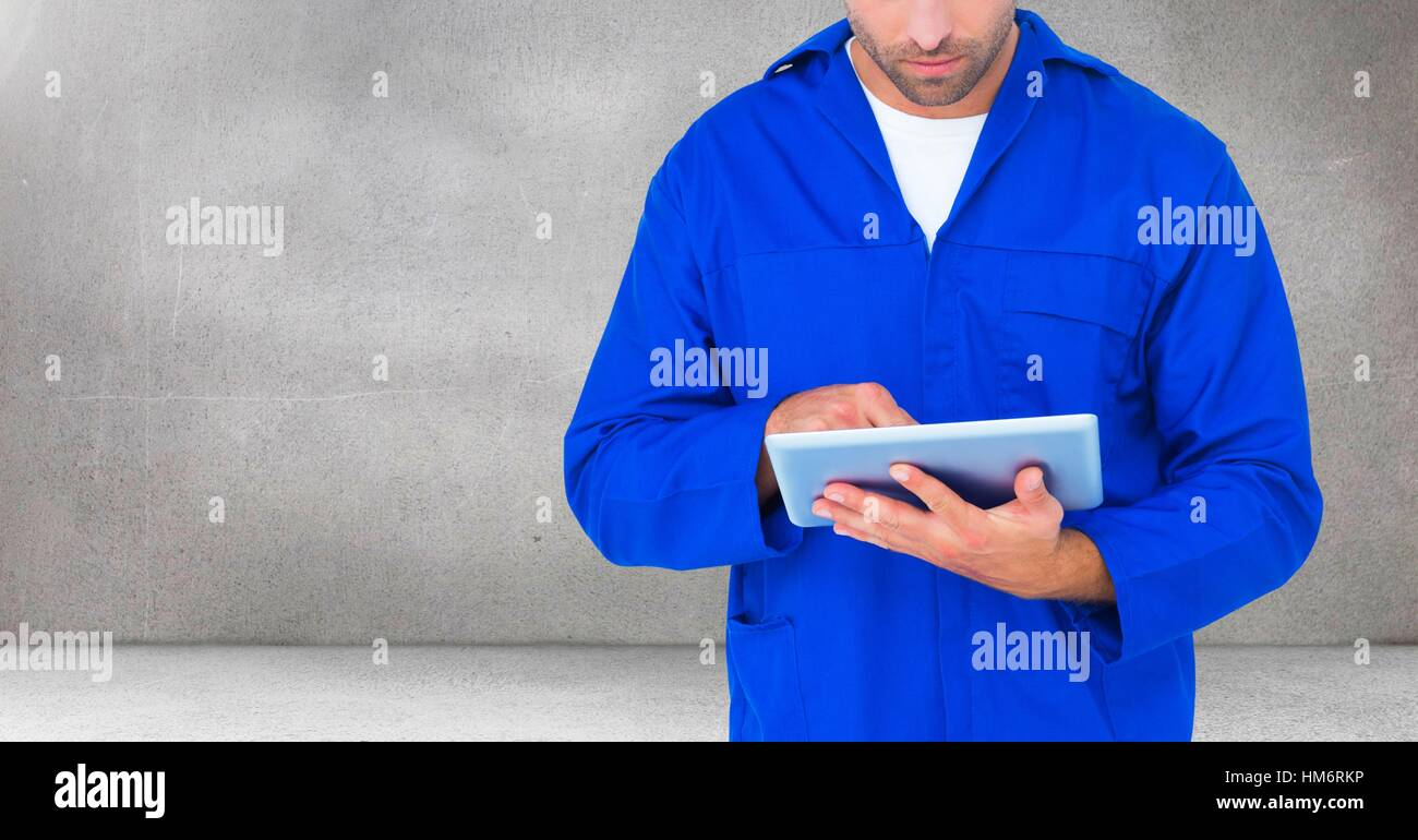 Serviceman using digital tablet - Stock Image