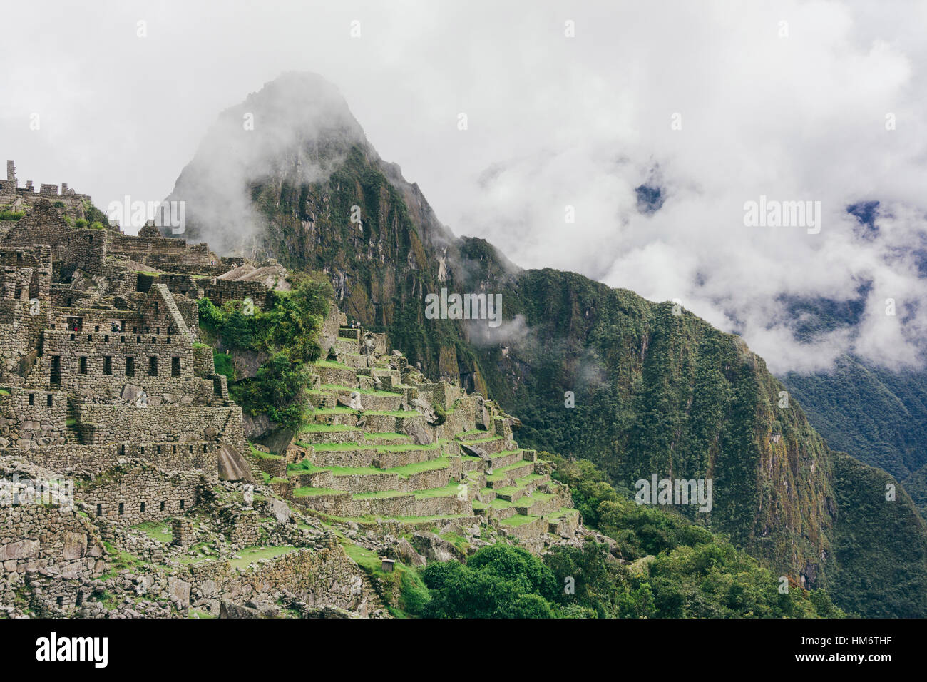 Scenic view of machu picchu with Mt huayna picchu during foggy weather - Stock Image