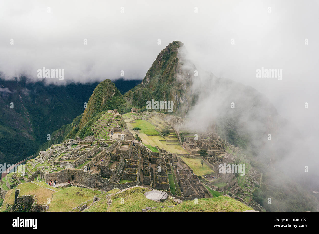 Aerial view of machu picchu with Mt huayna picchu during foggy weather - Stock Image