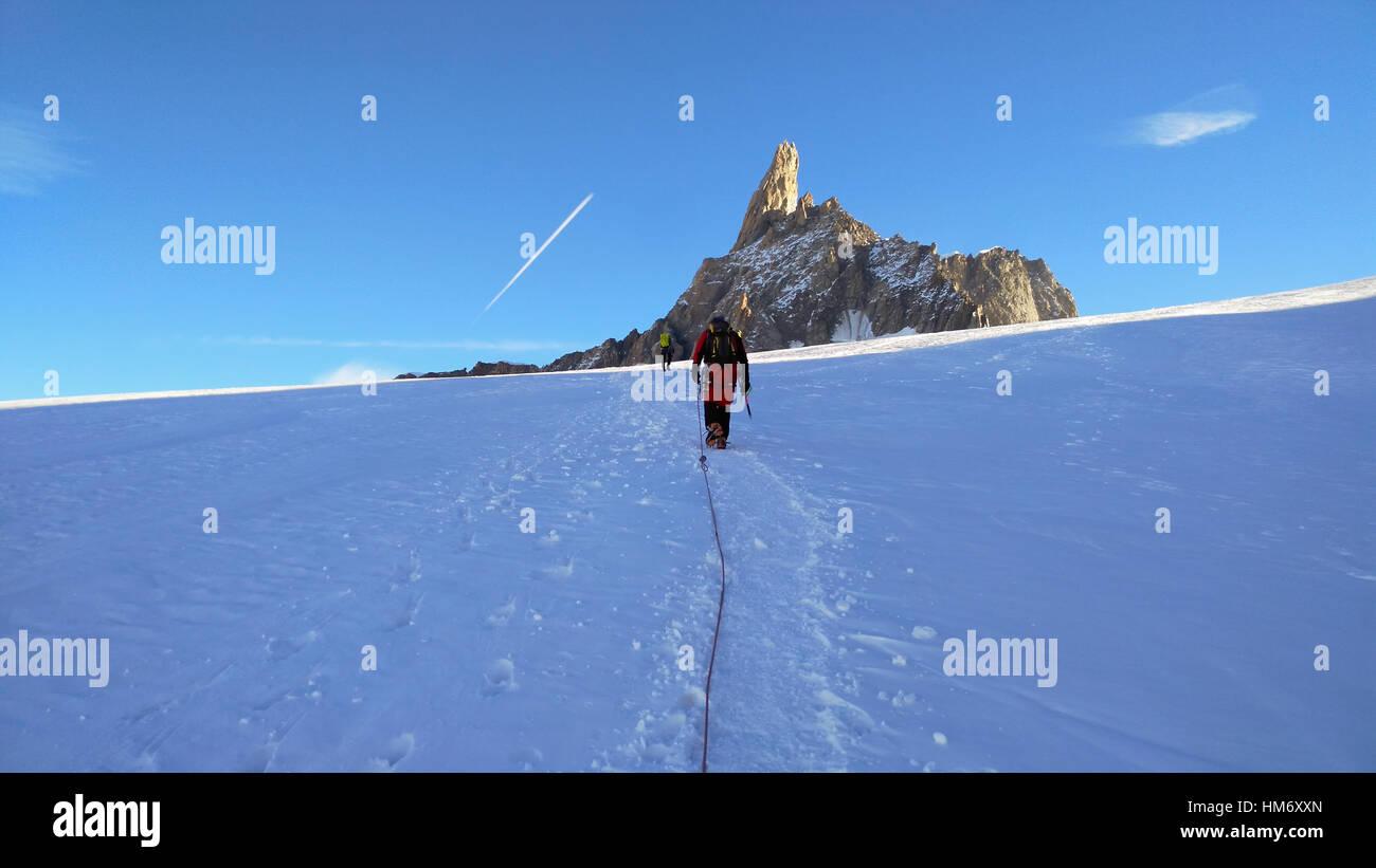 Climber on the glacier toward the Dent du Geant Stock Photo