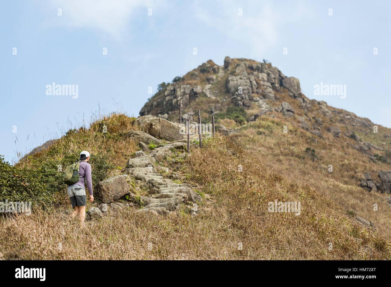 Hiking up Lantau Peak and Sunset Peak, on Lantau Island, Hong Kong, January 26 2017. - Stock Image