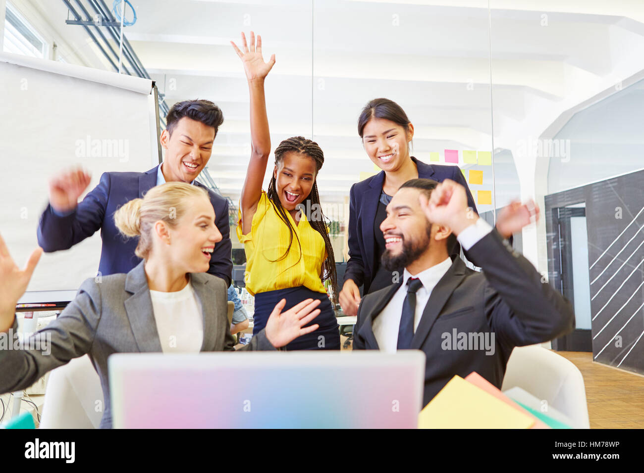 Founders of start-up celebrating with enthusiasm and cheering at the office - Stock Image