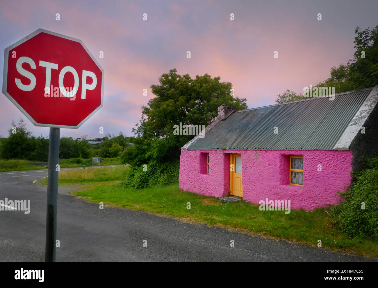 Pink cottage in rural Ireland. - Stock Image