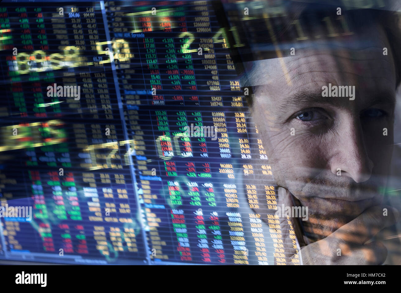 Face of mature man among stock exchange charts and numbers - Stock Image