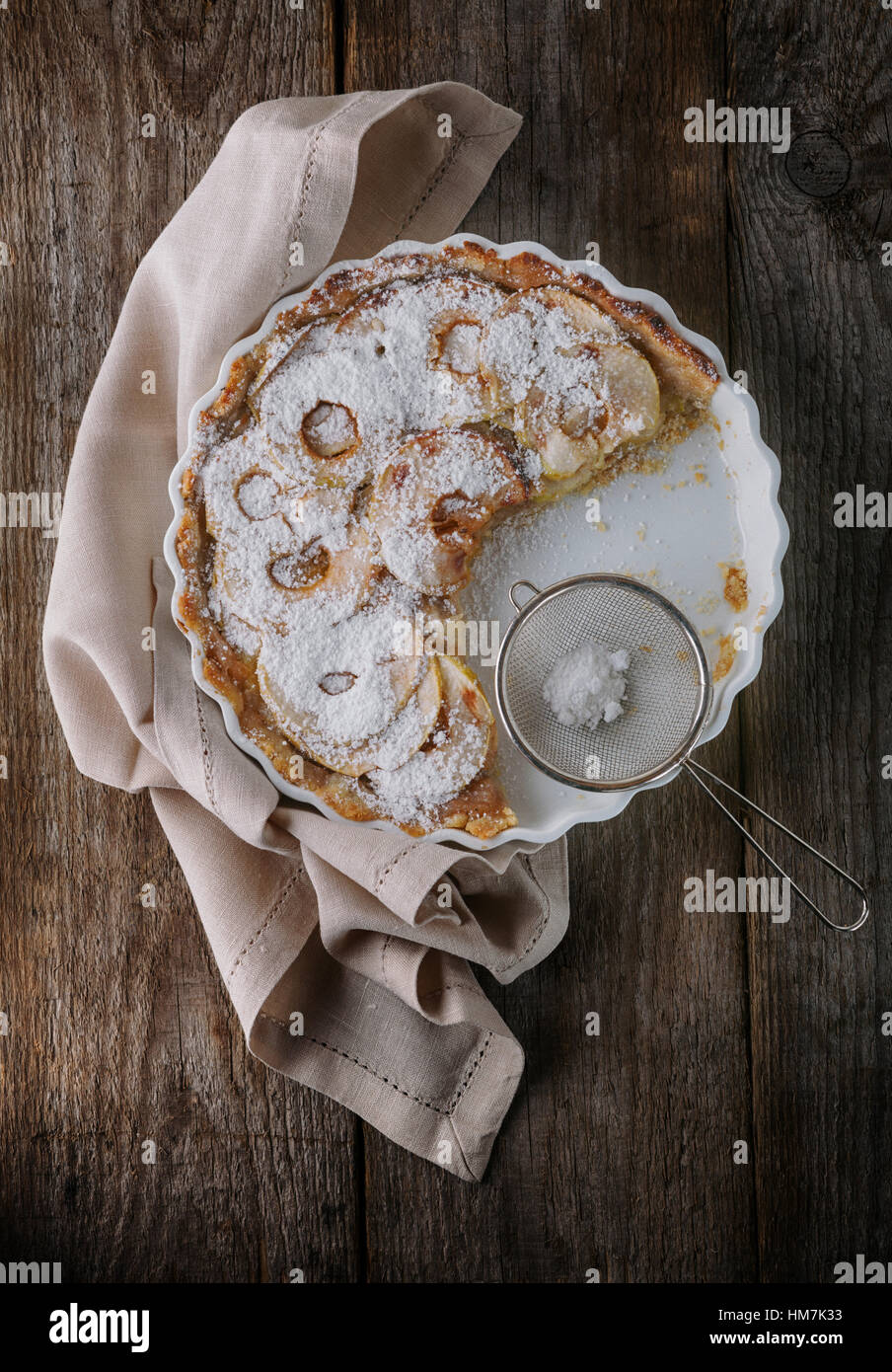 Apple pie and a napkin on wooden table - Stock Image