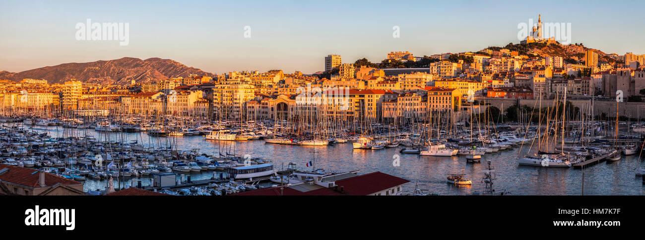 France, Provence-Alpes-Cote d'Azur, Marseille, Notre-Dame de la Garde above Vieux port - Old Port - Stock Image