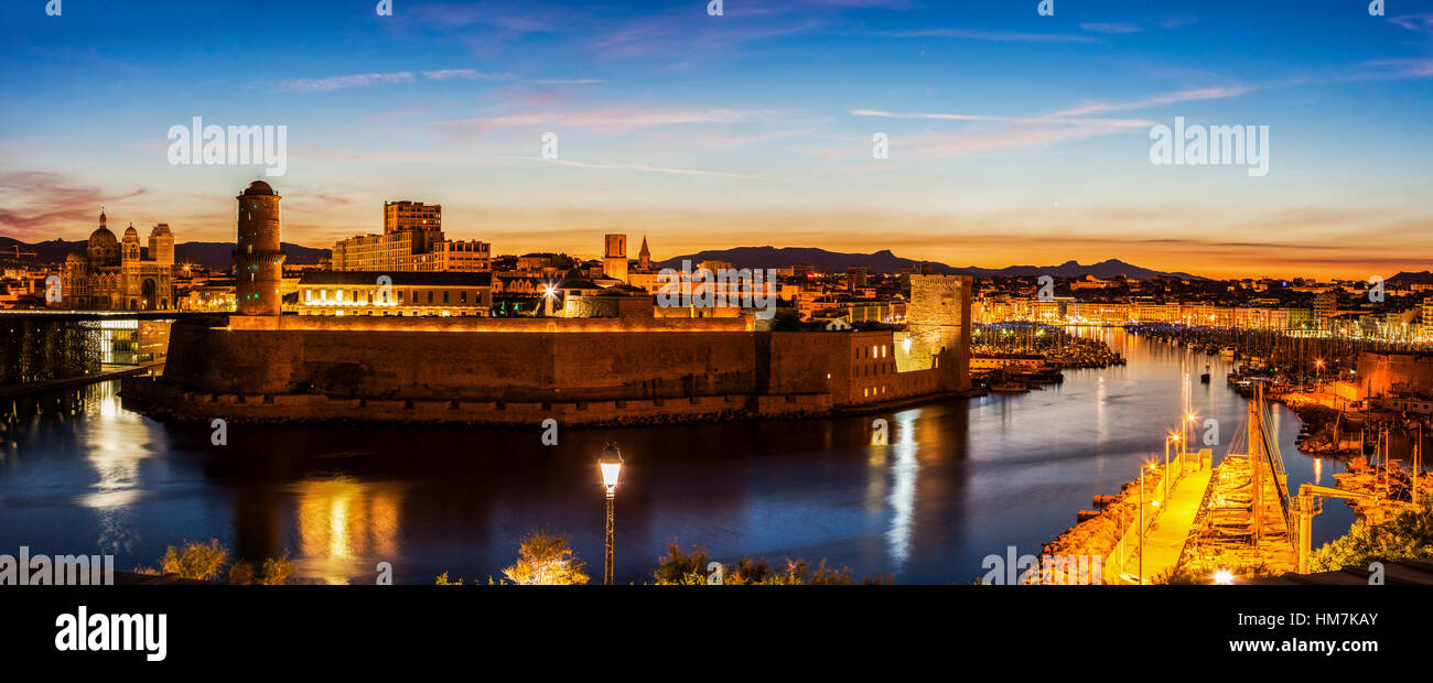 France, Provence-Alpes-Cote d'Azur, Marseille, Fort Saint-Jean and Marseille Cathedral at sunset - Stock Image