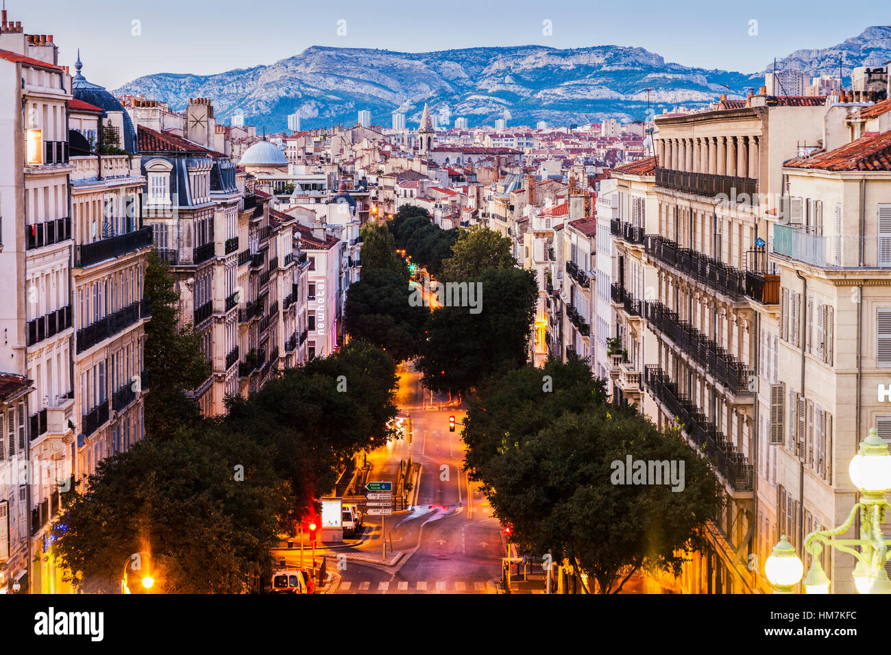 France, Provence-Alpes-Cote d'Azur, Marseille, Street in city, mountain in background - Stock Image