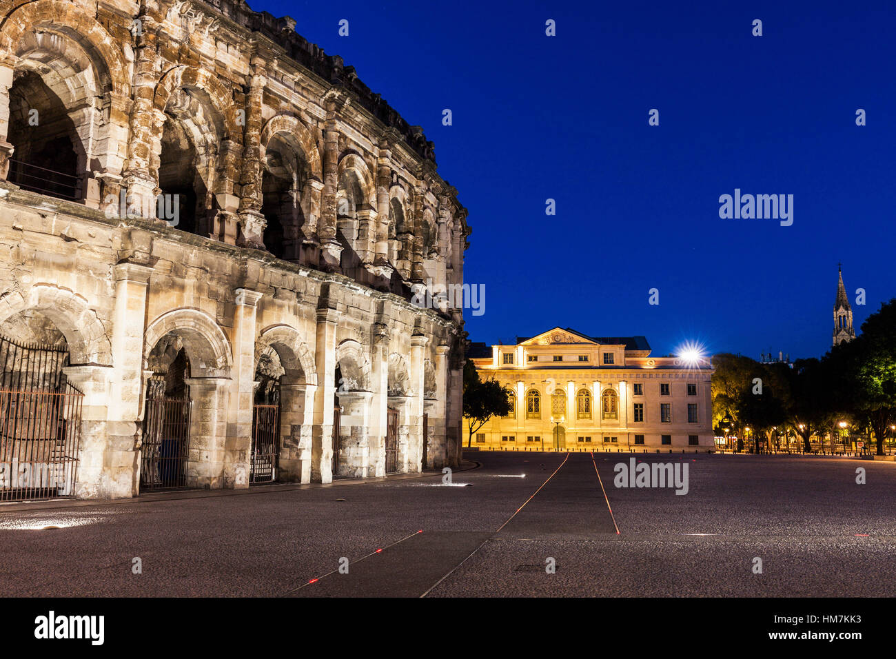 France, Occitanie, Nimes, Arena of Nimes at dusk - Stock Image
