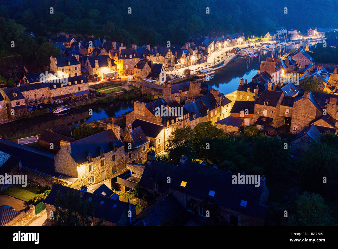 France, Brittany, Dinan, Cityscape with river at dusk - Stock Image