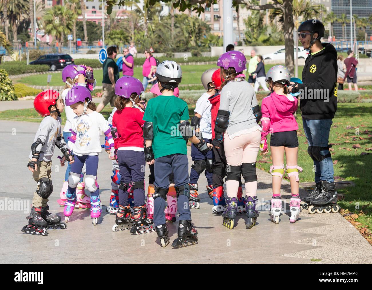 Children having Rollerblading lesson in Spain - Stock Image