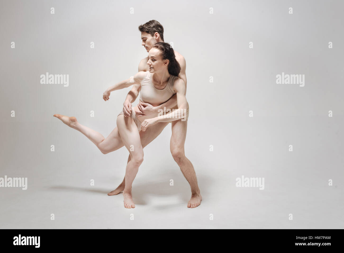 Athletic dance couple expressing their personality during the rehearsal - Stock Image
