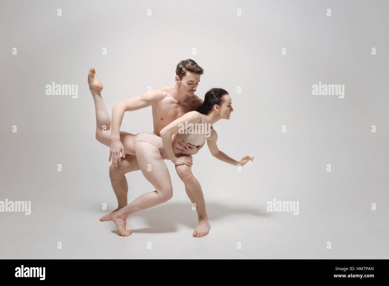 Eccentric dance couple expressing their personality during the rehearsal - Stock Image